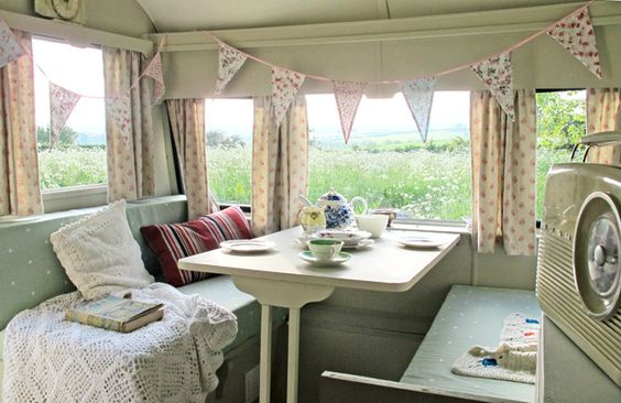 FFS...more bunting.  But the colors are lovely and it's a very sweet scene.  1957 Cheltenham Waterbuck vintage caravan interior
