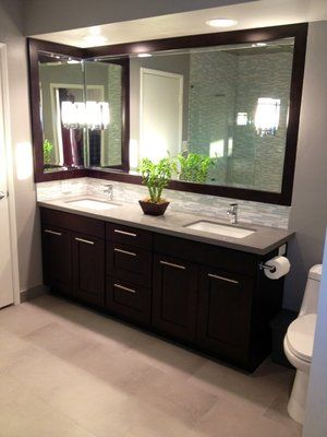"""Glendale restroom remodel after picture B. Double sink conversion, updated accents, and custom matching wood 3"""" mirror frame."""