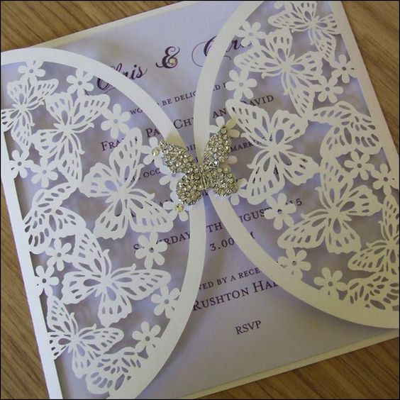This laser cut gatefold style wedding invitation features butterflies including a crystal butterfly embellishment. The insert is available in many colours.: