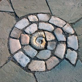 A lovely mosaic spiral addition to a walkway.