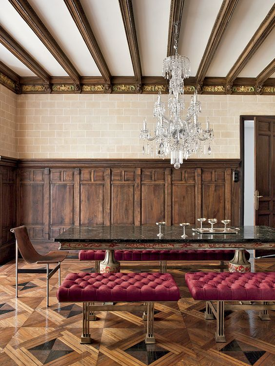 The dining room is a large room dominated by a huge table with polychrome marble…