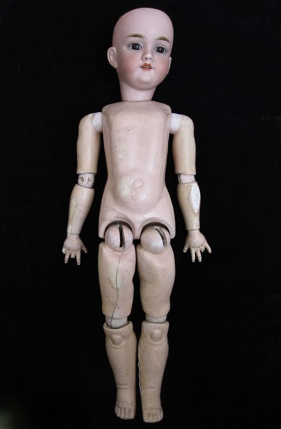 """21"""" Antique Simon Halbig Doll (#282) with 11 piece jointed composition body.  SOLD"""