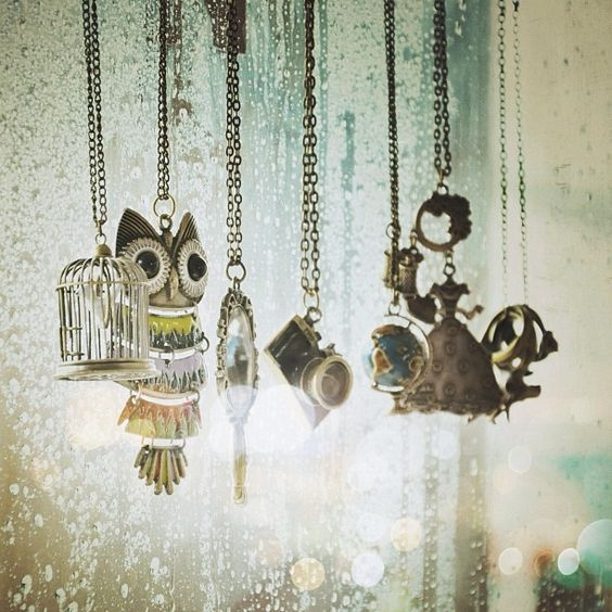 Owl, birdcage, globe, camera, and other charms on necklaces hanging by fiadarmafia from Instagram