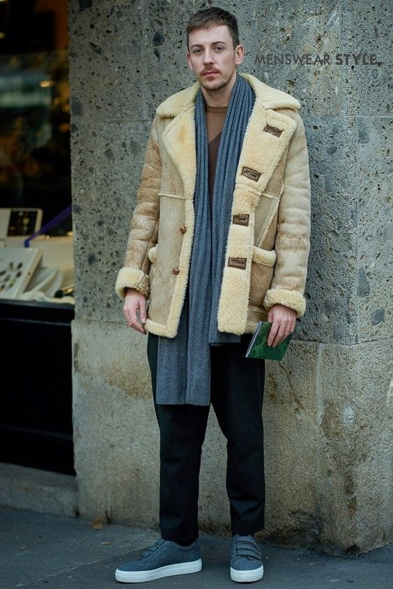 This dapper guy in Milan wears Shearling Coat, Three Strap Trainers, Brown T-Shirt and Grey Scarf.