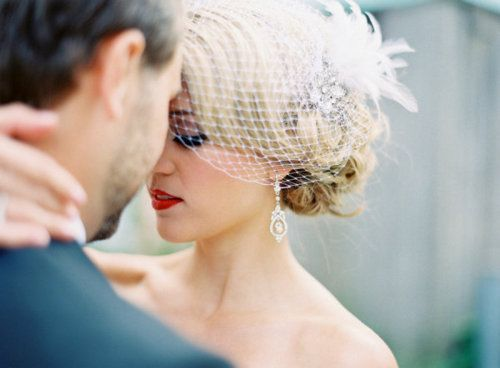 close up from behind groom with bride's eyes closed and hand on his neck