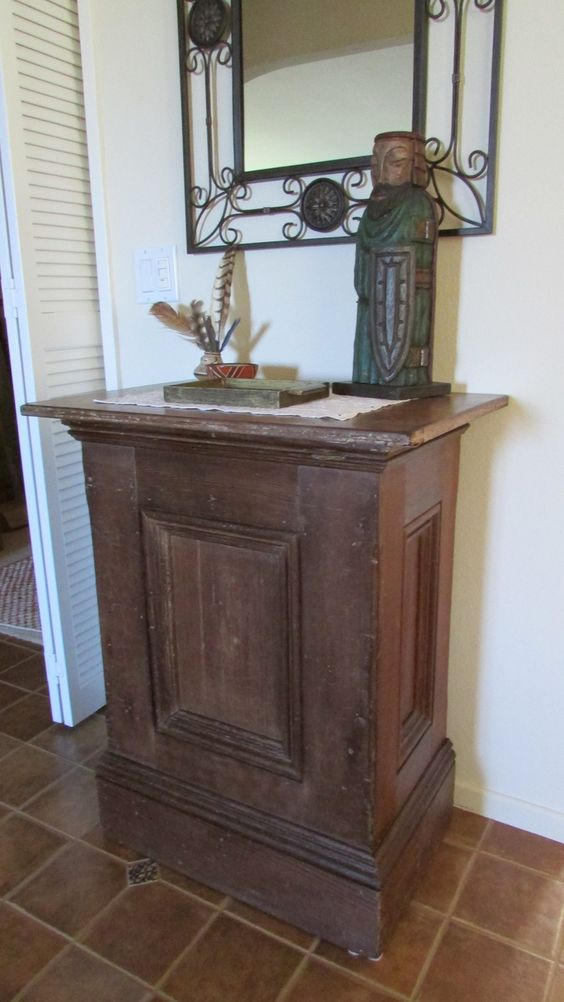 I found this antique podium this weekend. Cleaned it up a bit with some orange oil/wax and it looks fabulous in my foyer.