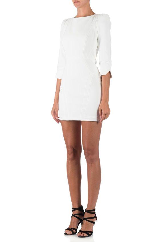 Witte jurk van Elisabetta Franchi. Jurk heeft een stevige stof en een aansluitende pasvorm. Aan de achterkant een open rug, welke voorzien is van een veter welke aangetrokken kan worden. Aan de zijkant van de jurk een gouden rits. Jurk heeft halve mouwen.