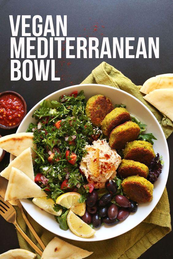 The ultimate Mediterranean Bowl with hummus, falafel, tahini sauce, olives and pita!