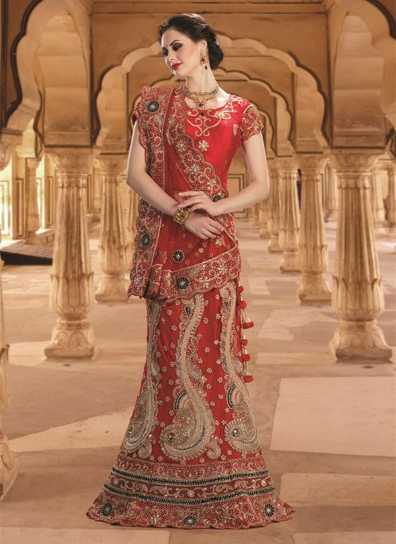 Be an angel and create and establish a smashing affect on anyone by carrying this red net a line lehenga choli. That you can see some interesting patterns performed with embroidered and resham work. C...