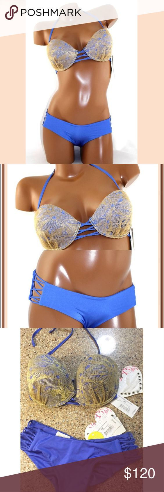 Beach bunny NWT take me there blue scrunch bikini This stunning bikini is such a pretty color in person! It has push-up style top with hipster style Brazilian and has added scrunch butt. Brand new with tags and lined! Size medium top and bottom. Beach Bunny Swim Bikinis