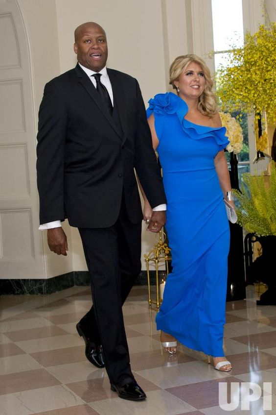 Mrs. Obama's brother and sister-in-law, Craig Robinson, College Basketball Analyst, ESPN and Kelly Robinson