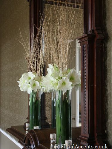 Wedding flowers - tall dramatic vases of gold birch and amaryllis for a winter wedding - by Floral Accents