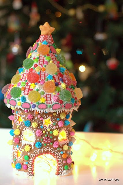 Beautiful gingerbread house tower or turret with cone roof and pink