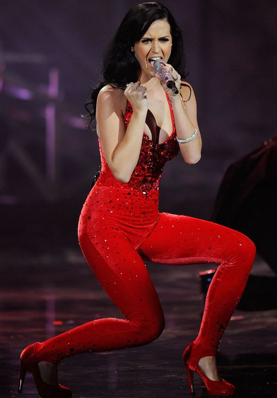 Katy perry wears a red velvet catsuit.