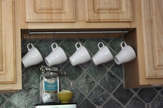 use a stainless steel rail and s hooks to hang coffee cups underneath your cabinets hogar. Black Bedroom Furniture Sets. Home Design Ideas
