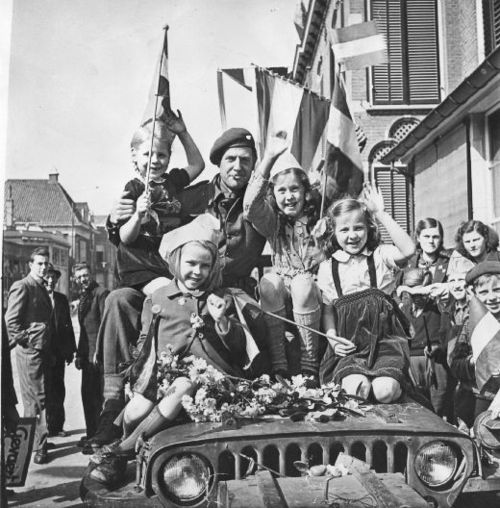 Children celebrate the surrender of the remaining German forces in the Netherlands with their Canadian liberators, May 5 1945