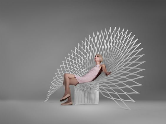 Peacock Chair from a single sheet of plastic | designed by Canadian firm uufie. #chaise #biomimétisme #paon: