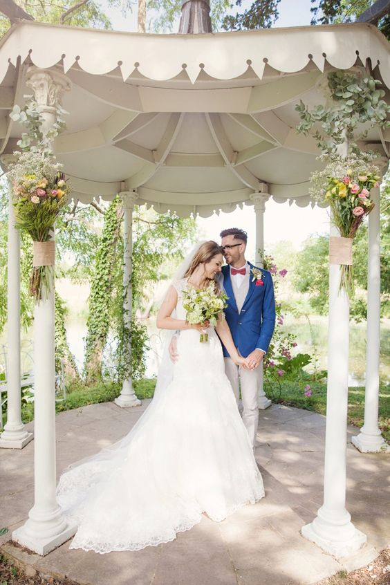 Kerry Ann Duffy Photography, Preston Court Wedding, Quirky Groom, wedding photo ideas, natural wedding photos, wedding gazebo, kent wedding, groom blue jacket, groom in glasses, groom red bow tie