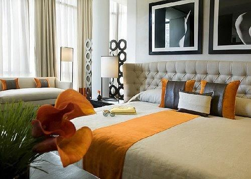 bedrooms - kelly hoppen bedroom orange black leather pillows ivory tufted wingback headboard hotel  Tufted wingback headboard, orange blanket