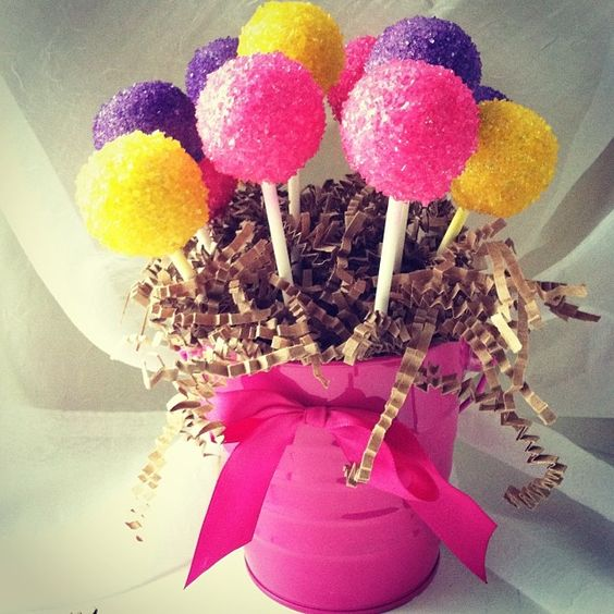 pink, yellow and purple cake pop bouquet. www.cakeballers.com #thecakeballers #cakeballers #cakeballer #cakeball #cakepops #cakeball #bucket #bouquet