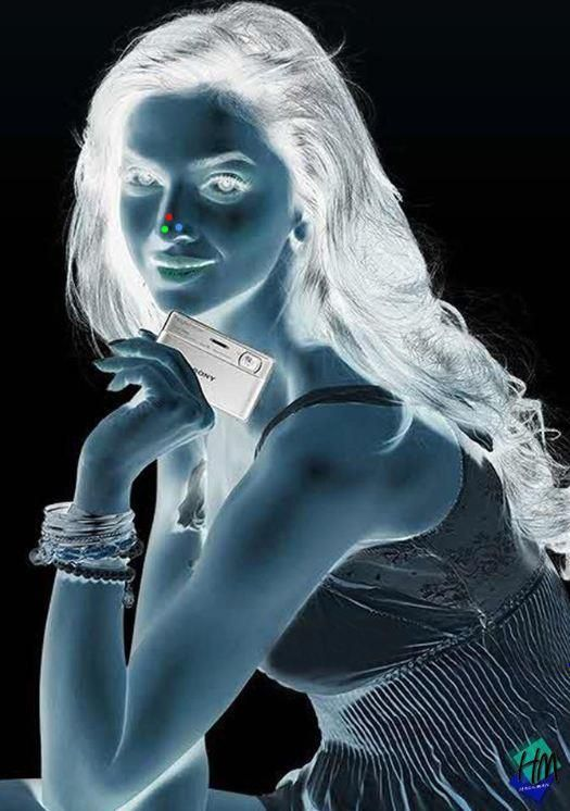 1. Stare at the red dot on the girl's nose for 30 seconds  2. Turn your eyes towards the wall/roof or somewhere else on a plain surface  3. Keep blinking your eyes quickly !!