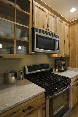 Brookstone Builders contemporary kitchen like the knotty pine and open cabinets, lights too