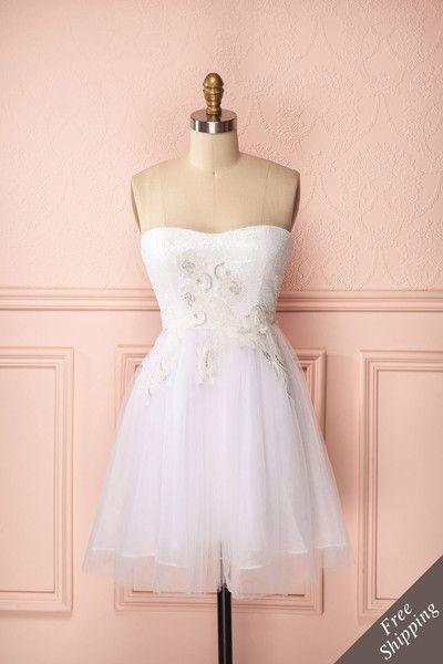 Saralyn ♥ Les paillettes d'ivoire et les broderies d'argent font de cette robe…