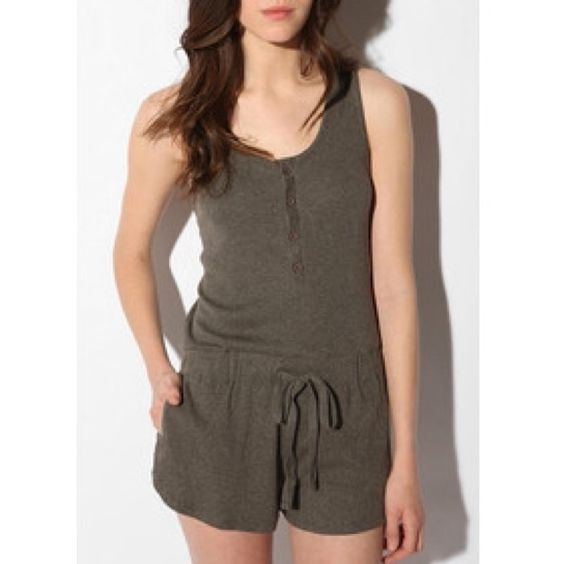 """byCORPUS Ribbed Cotton Romper By byCORPUS.  This ribbed cotton romper is wonderfully soft and comfortable!  Perfect to lounge around in as well as wear out with it's basic, yet not-so-basic style.  Features:  Front of romper has buttons on top and tie on bottom;  Bottom of romper has 2 side pockets and 1 rear pocket;  85% polyester;  15% cotton;  Hand wash;  Comes with an extra button attached on inside of garment on """"care"""" tag.  Never worn.  NWT Urban Outfitters Pants Jumpsuits & Rompers"""