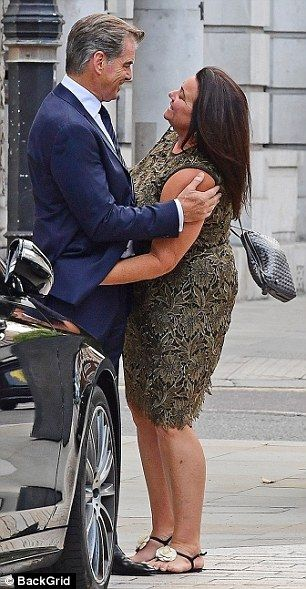 Inseparable: After more than 17-years of married life Piere Brosnan and wife Keely Shaye Smith proved they are still prone to spontaneous romantic displays of affection as they stepped out in London on Wednesday
