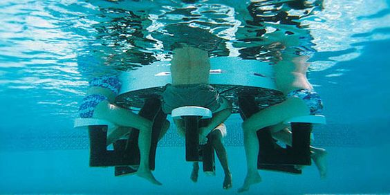 A Floating Pub Table For The Pool Complete With Stools And Built In Ice Chests It Also Has An