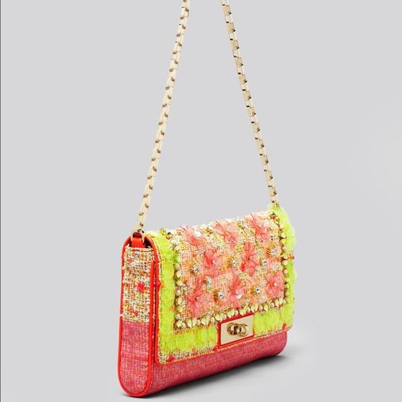 NWOT Kate Spade Garden Grove Felisha VERY RARE HTF Stunning brightly, multicolored tweed clutch/bag. Tuck chain away and wear as a clutch. Gorgeous crystal, sequin and bead embellishments. This is a $500 limited edition KS retail bag. I just never found an occasion to wear it. Take a rare opportunity to add a collector's bag to your closet! kate spade Bags