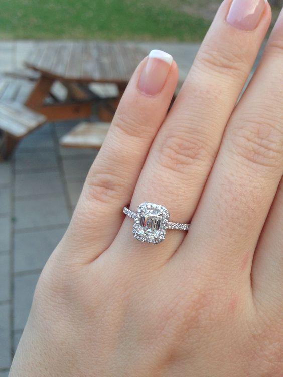 1 carat emerald cut with halo wedding rings
