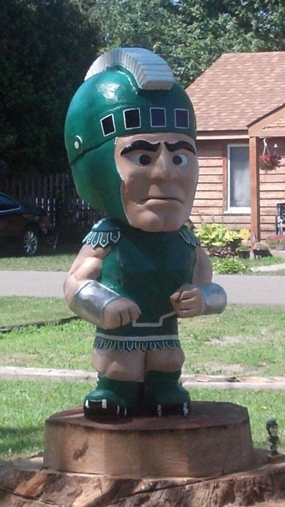 Lexington, MI.  What once was a knocked down tree delivers Spartan spirit.
