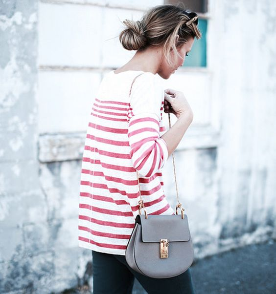 Mary Seng is wearing a red and white striped top from Rag & Bone and the small leather bag is from Chloe