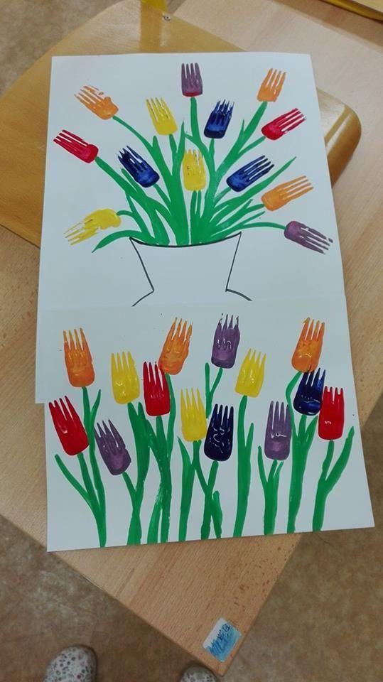 Kids painting with forks. What a great sensory and fine motor skill. #springactivities #paintingideasforkids #paintforkids #kidspainting #springtheme #lovetoplay
