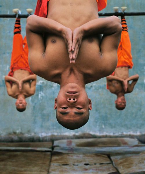 Henan Province, China. Young monks train at the Shaolin Monastery. The physical strength and dexterity displayed by the monks is remarkable, as is their serenity. Photo © Steve McCurry/Magnum Photos