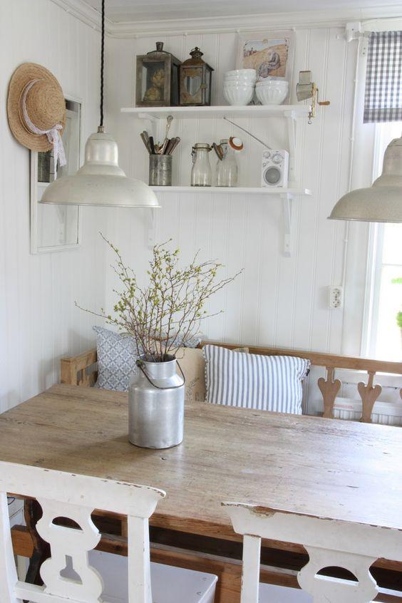 Blue and white Swedish farmhouse kitchen with beautiful European country decor and barn style pendants. #kitchen #swedish #breakfastnook #farmtable
