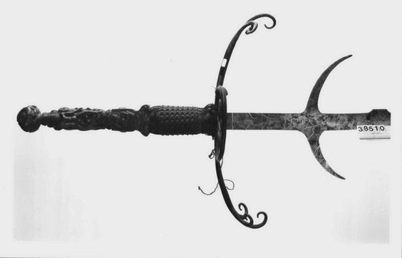 A German two-handled sword with a long, undulating steel blade and handle, with padded upper and lower grips, protected by double quillons, and a brass pommel.