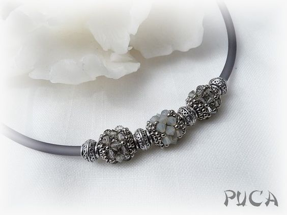 Necklace by Puca. Silver and gray bicones.