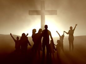 Image of silhouettes of family and people at the cross of jesus.