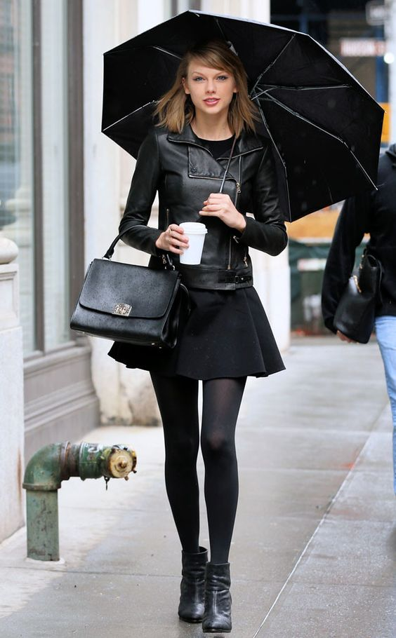 Cloudy Skies from Taylor Swift's Street Style Taylor makes rainy day dressing look so stylish in this black leather jacket, mini skirt and tights.: