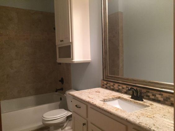 guest bath, granite counter tops, custom framed mirror