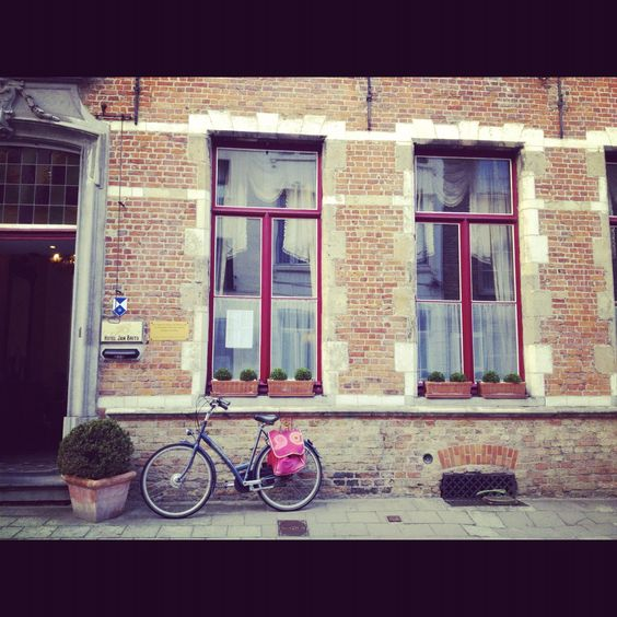 Infront of our cute hotel in Bruges this summer..so charming!