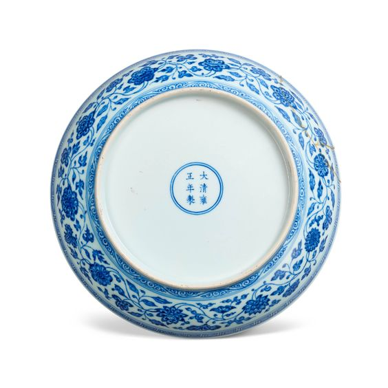 A BLUE AND WHITE 'FLORAL' DISH, YONGZHENG SIX-CHARACTER MARK IN UNDERGLAZE BLUE WITHIN A DOUBLE CIRCLE AND OF THE PERIOD (1723-1735) | Christie's
