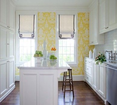yellow wallpaper, trimmed out window treatments