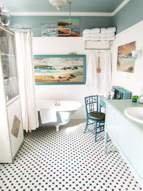white bathroom with grey blue ceiling + hints of varied blue accents