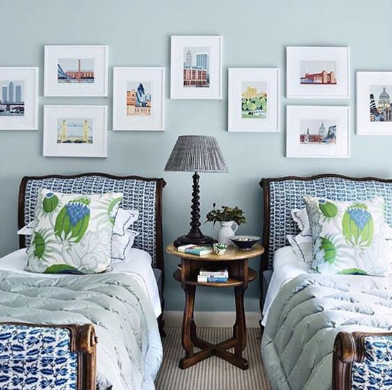Sarah Bartholomew Traditional Colorful Decor. Vibrand blue and green in a bedroom with twin beds and art gallery wall.