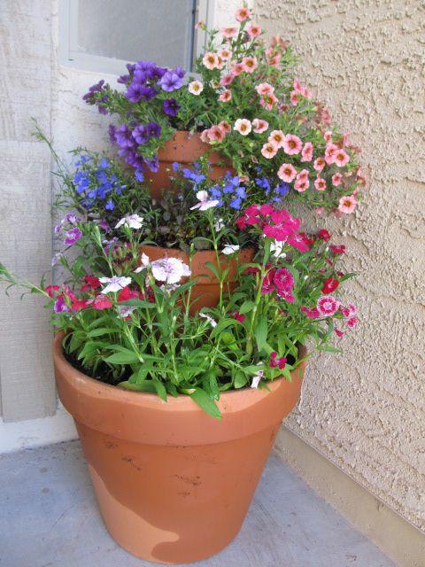 Tiered flower pot by the front door.