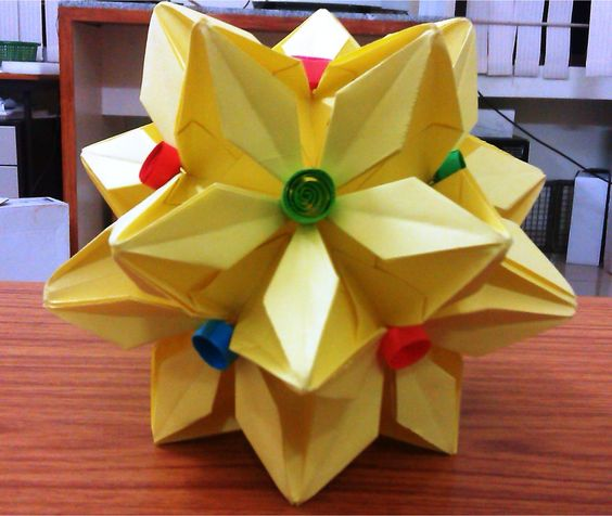 Yellow Paper Kusudama, with multi color quilled coils.
