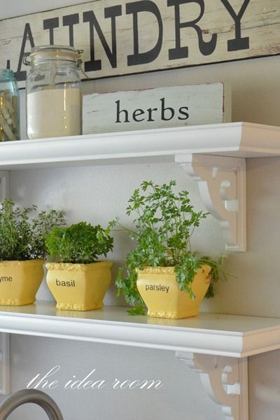 Love the yellow potted herbs